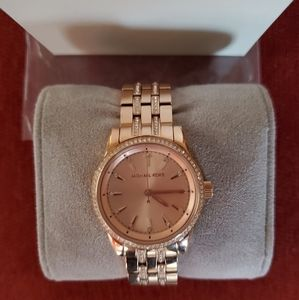 Women's rose gold in color watch with rhinestones